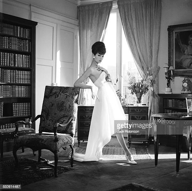A woman models the latest designs from the house of Dior late 1960s or early 1970s
