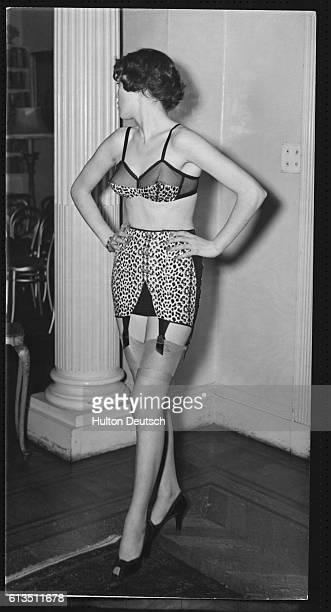 A woman models underwear by Belinda Bellville and Synda Scott at a show of their autumn collection She wears a leopard print brassiere and girdle...