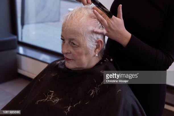 Grey haired woman at the hairdresser