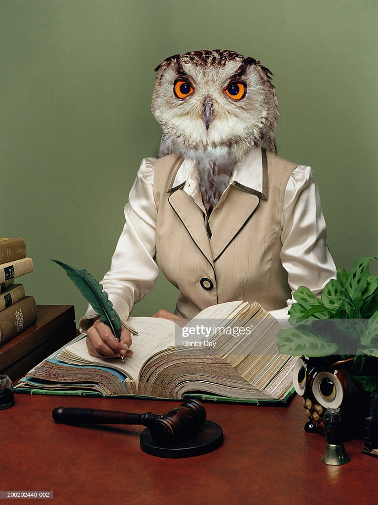 Woman morphed as an owl writing at desk with quill (Digital Composite) : Stock Photo