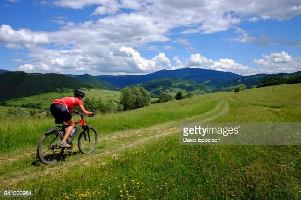 Woman mountain biking in Mala Fatras mountains of Slovakia