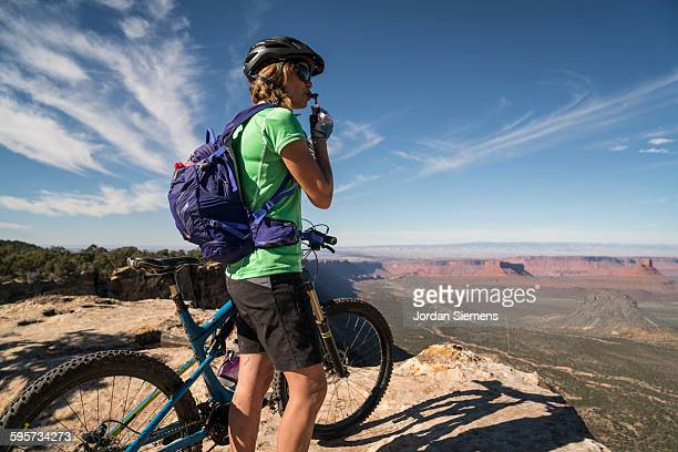 A woman mountain biking.