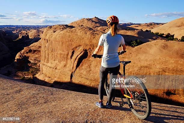 Woman mountain biking Slickrock in Moab