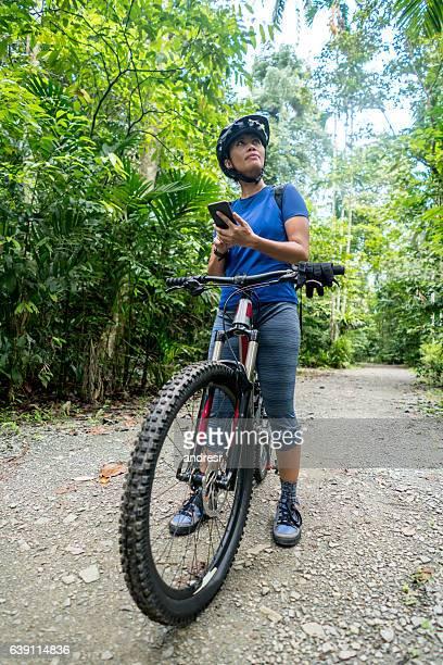 Woman mountain biking with GPS