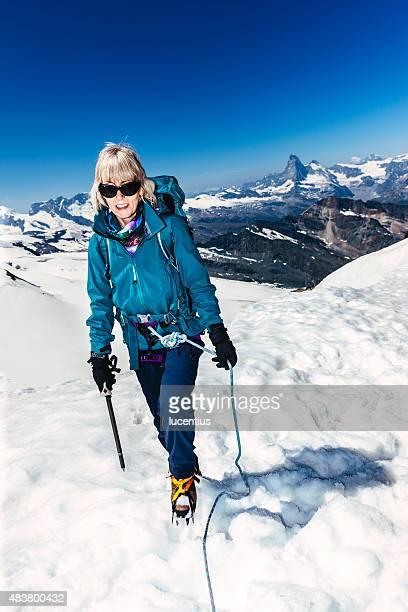 Mujer alpinismo en Suiza