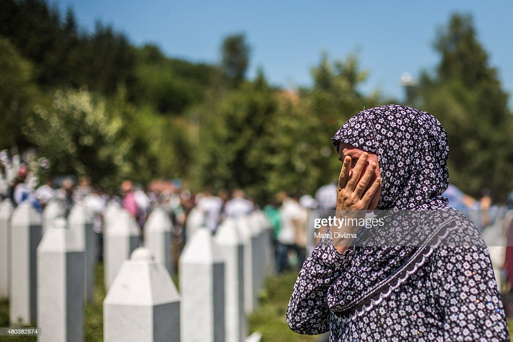 A woman mourns after the mass funeral for 136 newly-identified victims of the 1995 Srebrenica massacre attended by tens of thousands of mourners during the 20th anniversary of the massacre at the Potocari cemetery and memorial on July 11, 2015 in Srebrenica, Bosnia and Herzegovina. At least 8,3000 Bosnian Muslim men and boys who had sought safe heaven at the U.N.-protected enclave at Srebrenica were killed by members of the Republic of Serbia (Republika Srpska) army under the leadership of General Ratko Mladic, who is currently facing charges of war crimes at The Hague, during the Bosnian war in 1995.