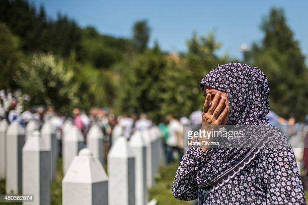 A woman mourns after the mass funeral for 136 newlyidentified victims of the 1995 Srebrenica massacre attended by tens of thousands of mourners...