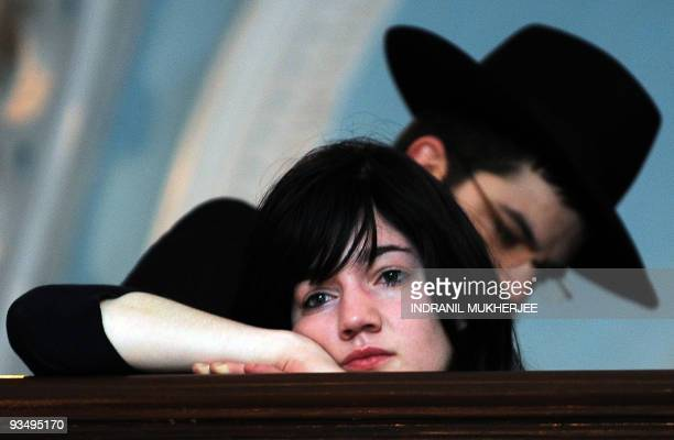 A woman mourns as members of the Jewish orthodox Chabad Lubavitch movement of New York attend a memorial service in memory of victims of last year's...
