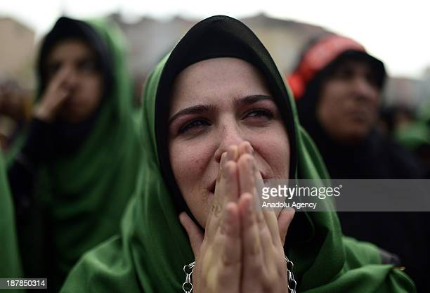 A woman mourns as she enchains herself through the universal Ashura Day that is held at Halkali Arena Park on November 13 2013 in Istanbul Turkey...