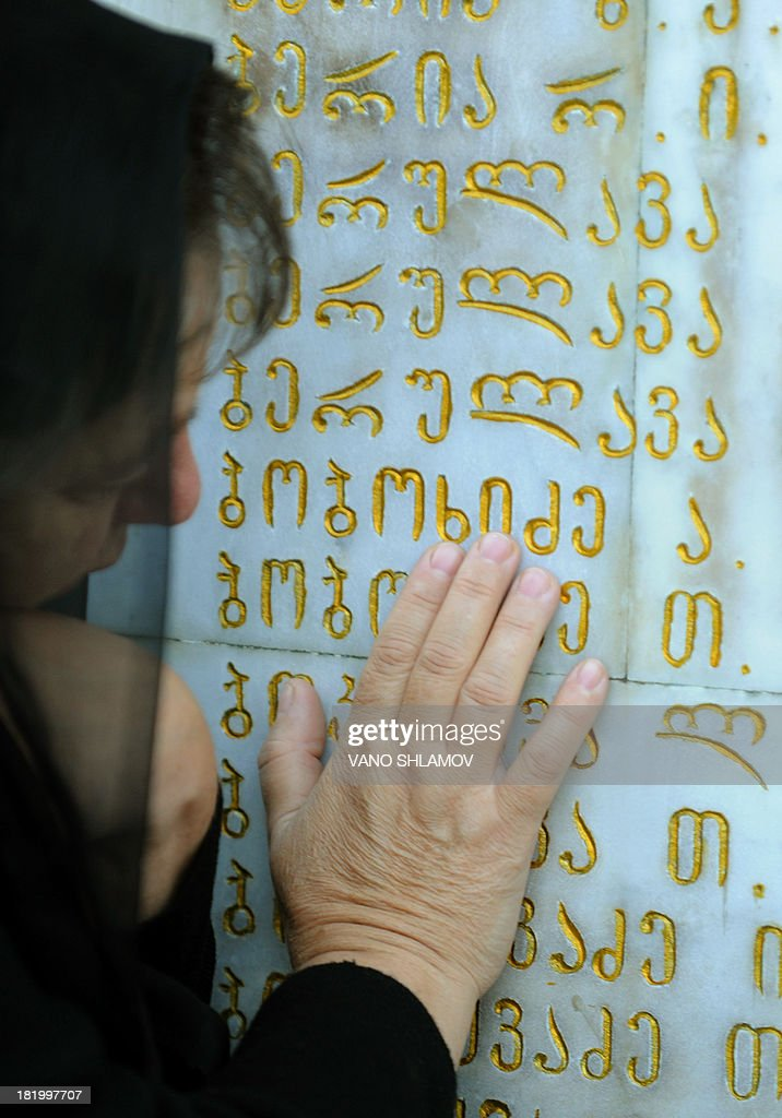 A woman mourns at a memorial to Georgians killed during the 1992-1993 armed conflict in Abkhazia during a ceremony to mark the annual anniversary of the event in Tbilisi, on September 27, 2013. Abkhazian separatists waged a war with Georgia in the 1990s after the break-up of the Soviet Union that killed several thousand people and left 250,000, mostly ethnic Georgians, as refugees. Georgia insists that Abkhazia is an integral part of its territory but Russia has recognised it and South Ossetia as independent states following its brief conflict with Georgia in 2008.