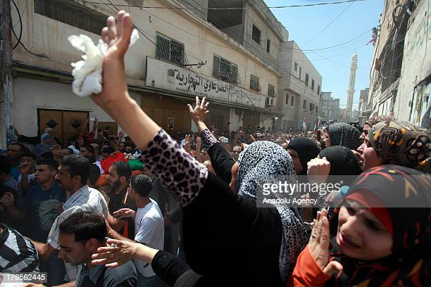 Woman mourns at the funeral of three Palestinians on August 262013 at the Qalandia Refugee Camp near Ramallah Palestine The 3 Palestinians died...
