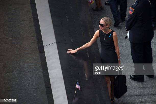 A woman mourns at the names plaques at the 9/11 Memorial during ceremonies for the 12th anniversary of the terrorist attacks on lower Manhattan at...