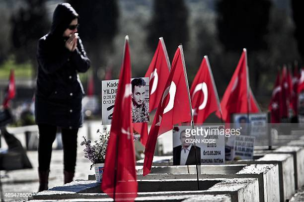 Woman mourns at the Soma cemetery where miners killed in the worst industrial accident in Turkey's history are buried in Manisa on April 12, 2015....