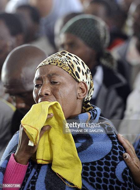 A woman mourns during a memorial service for the 44 people killed in a wildcat strike at Lonmin's Marikana mine on August 23 2012 in Marikana Lonmin...