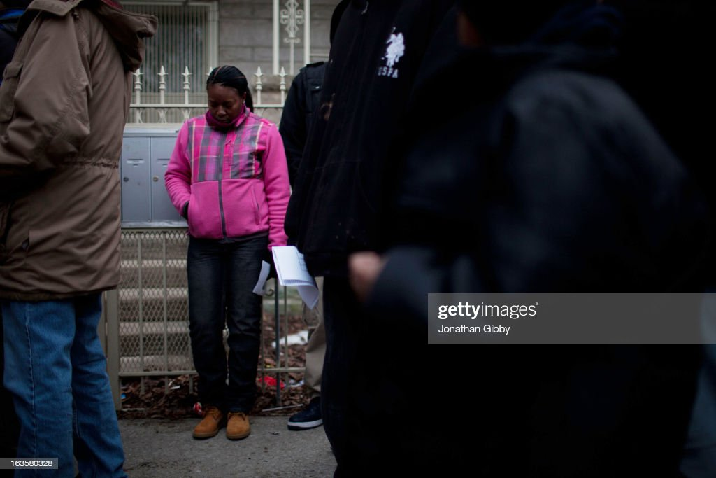 A woman mourns during a vigil for slain infant Jonylah Watkins on March 12, 2013 in Chicago, Illinois. The 6-month-old girl was shot five times on the 6500 block of South Maryland Avenue while her father was changing her diaper in the passenger seat of his car. The father, Jonathan Watkins remains is stable condition at Nothwestern Memorial Hospital after receiving three gunshot wounds.