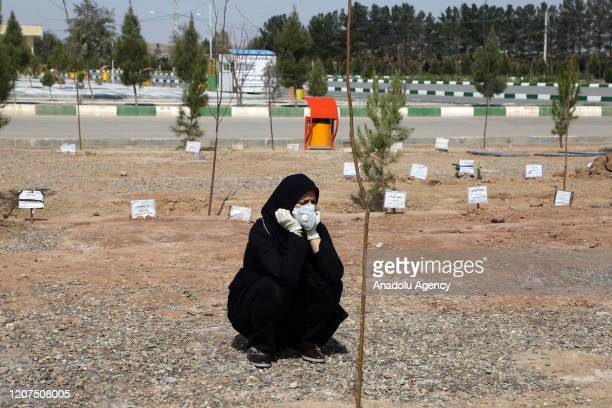 A woman mourns during funeral held at Beheshte Masoumeh Cemetery for the victims of coronavirus in Qom Iran on March 17 2020 The death toll in Iran...