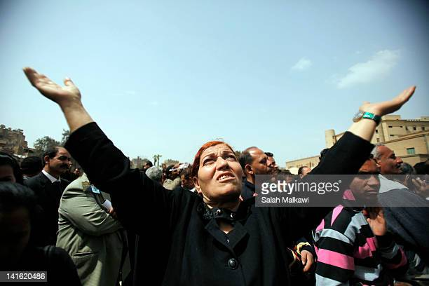 A woman mourns during the funeral of Pope Shenouda III the head of Egypt's Coptic Orthodox Church near the Abassiya Cathedral March 20 2012 in Cairo...
