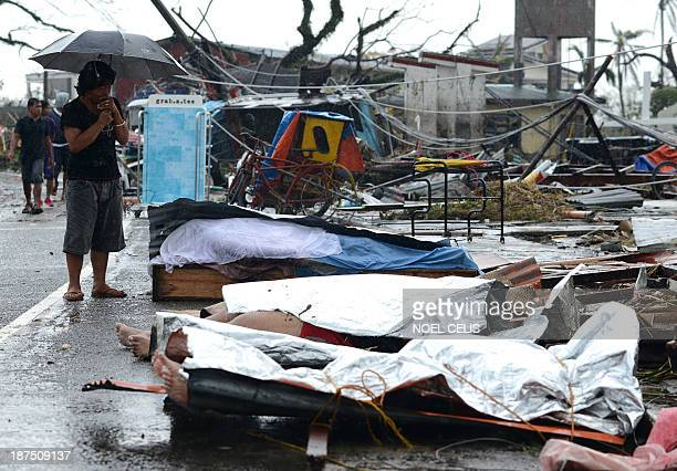 Woman mourns in front of her husband's dead body in a street of Tacloban, eastern island of Leyte on November 10, 2013. The Pentagon said it was...