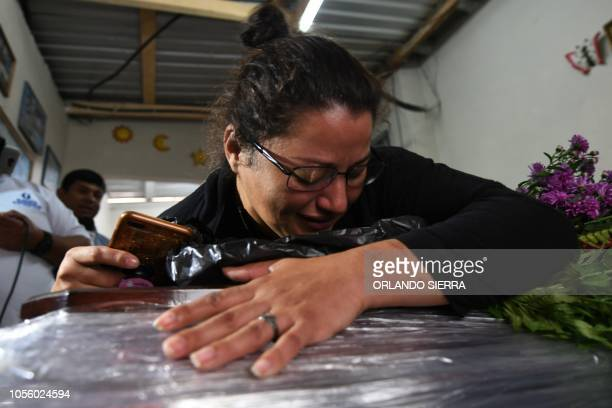 Woman mourns over Honduran migrant Henry Adalid Diaz Reyes' coffin in Tegucigalpa on November 1, 2018. - Diaz was killed after a rubber bullet hit...