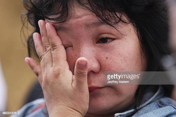 A woman mourns the 57 people killed in a massacre on November 23 2009 at the site of massacre on January 23 2010 in the township of Ampatuan...