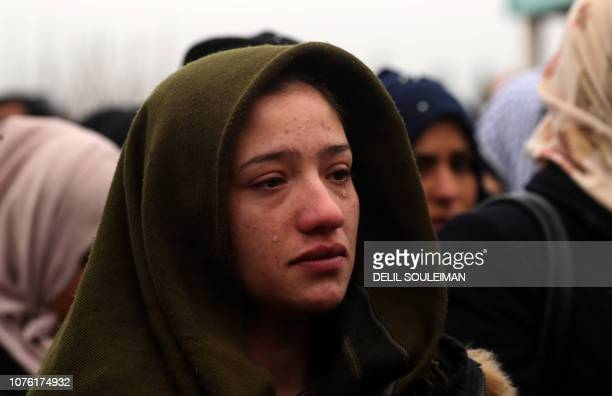 Woman mourns the death of a local official, who Fighters from the Syrian Democratic Forces say was assassinated in a Kurdish-held area in the...