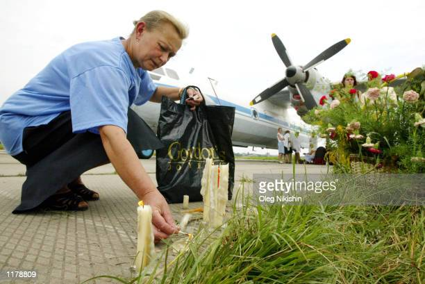A woman mourns the death of her daughter two granddaughters and her soninlaw at the SU27 crash site July 29 2002 in Lviv Ukraine Residents in this...