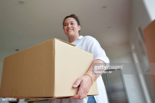woman moves into her new home - rafael ben ari stock pictures, royalty-free photos & images