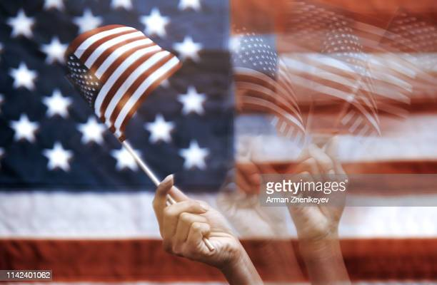 woman moving american flag. motion blurred photo - démocratie photos et images de collection