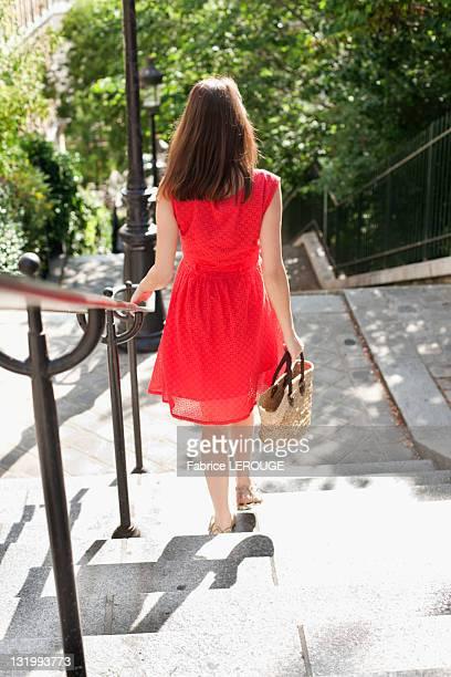 woman moving down staircases, montmartre, paris, ile-de-france, france - railings stock pictures, royalty-free photos & images