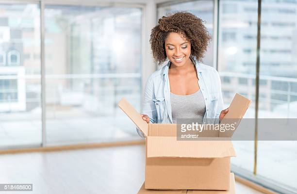 Woman moving house and unpacking