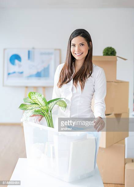woman moving house - belongings stock photos and pictures