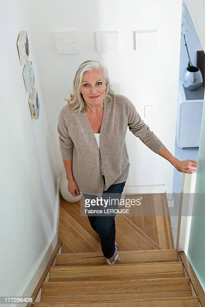 Woman moving up on a staircase