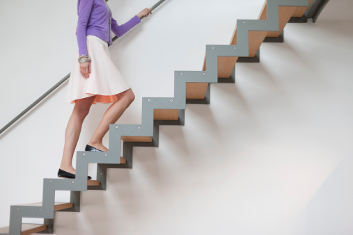 Woman moving up stairs - gettyimageskorea