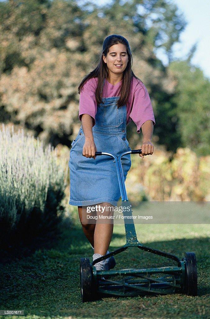 Senior Woman Mowing Lawn Royalty Free Stock Image - Image