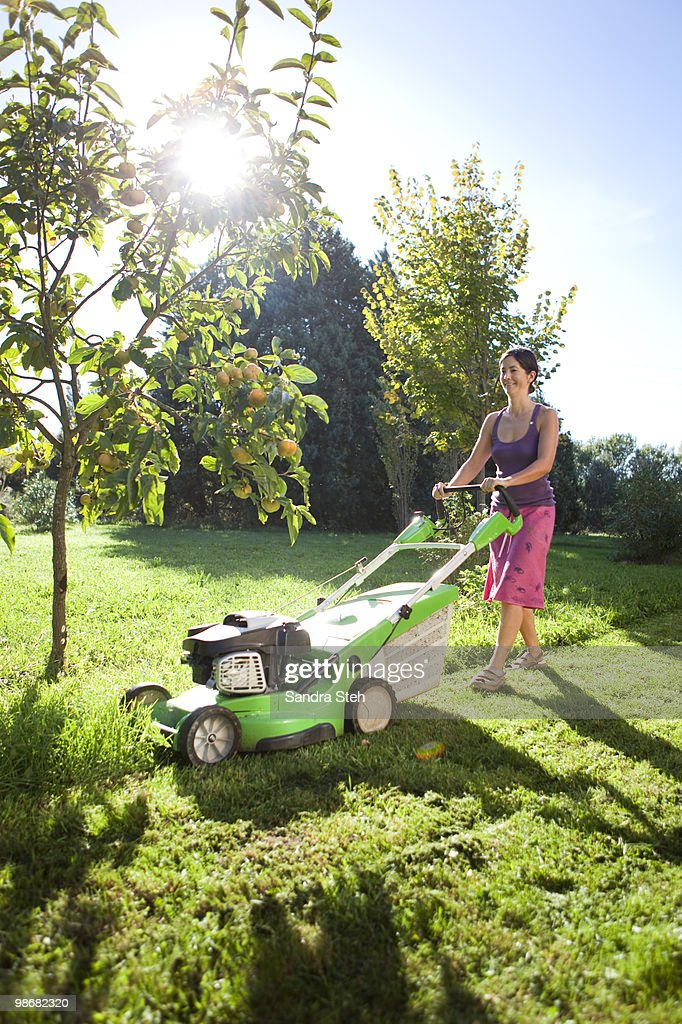 Woman Mowing Green Grass Stock Photo - Download Image Now