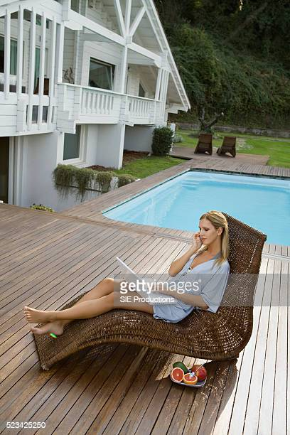 Woman Multitasking by a Pool