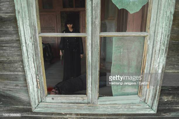 woman murdered man seen through broken window - serial killings stock pictures, royalty-free photos & images