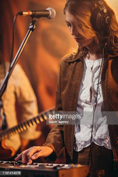 woman musician playing keyboard on stage - keyboard player stock pictures, royalty-free photos & images
