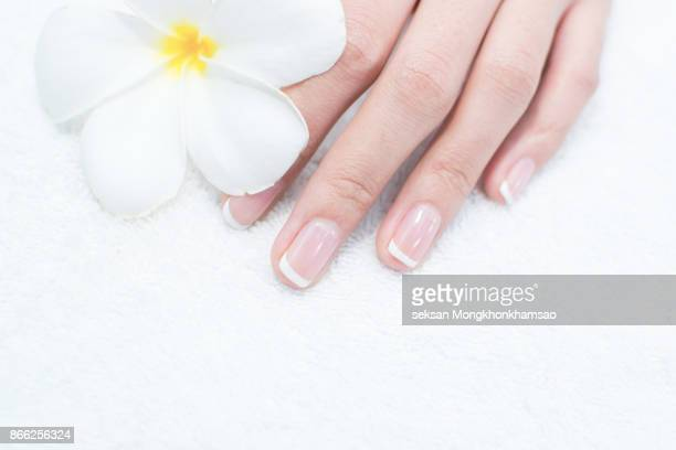 Woman nail care, and flowers