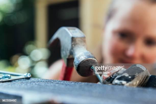 Woman nailing outdoor.