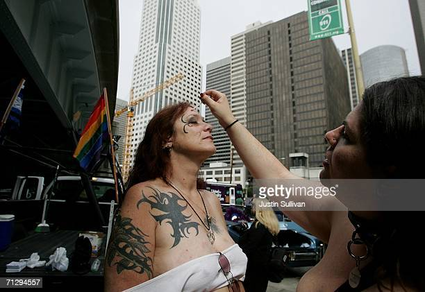 """Woman named """"Pandorah"""" has her makeup applied by her friend """"Girl"""" before the start of the 36th annual LGBT Pride Parade June 25, 2006 in San..."""