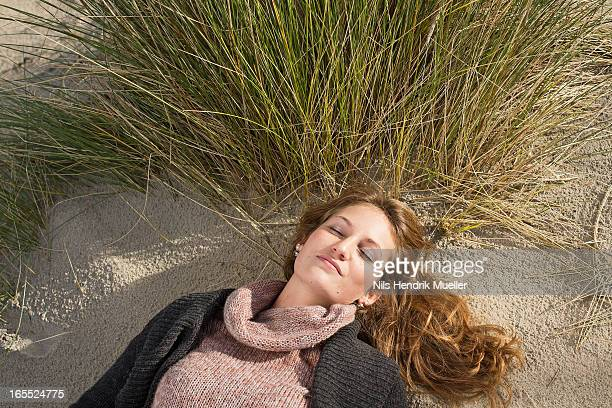 Woman napping on beach