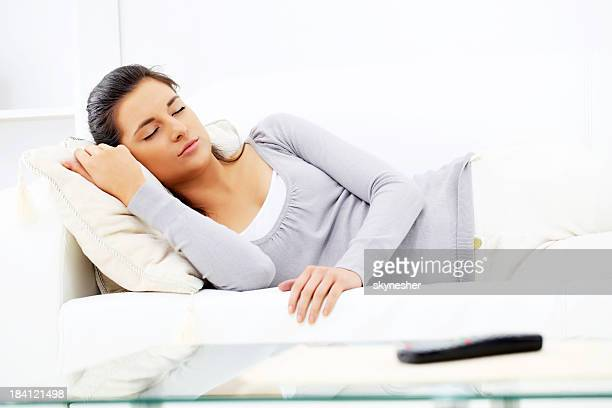 Woman napping on the living room.