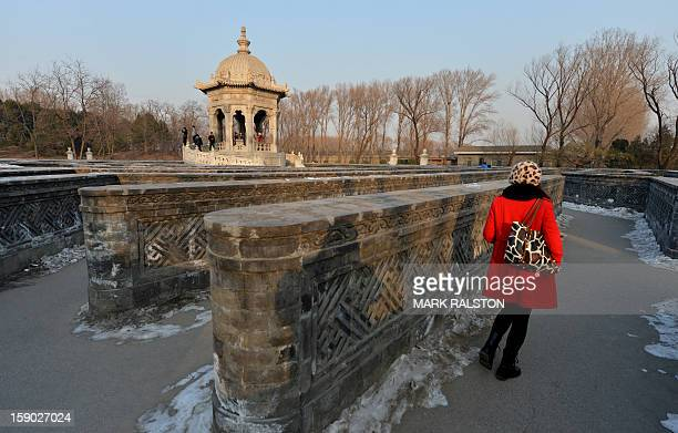 A woman navigates around the historic Jesuit designed Huánghuazhèn maze at the Old Summer Palace in Beijing on January 6 2013 The Old Summer Palace...