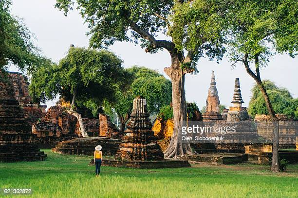 woman near ancient buddhist temple - ayuthaya province stock pictures, royalty-free photos & images