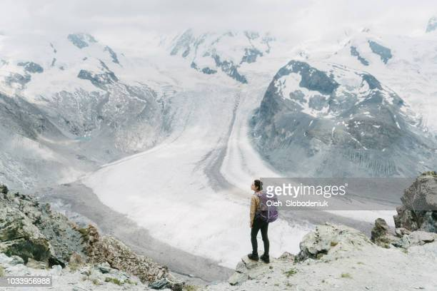 Woman near the glacier in Swiss alps