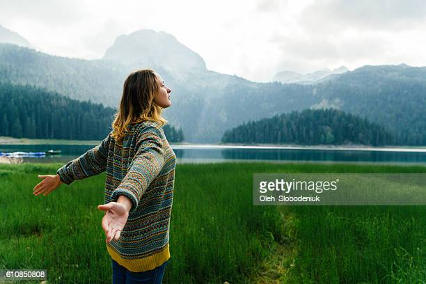 woman near the lake in mountains - non urban scene stock pictures, royalty-free photos & images