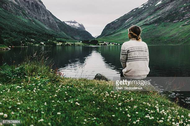 woman near the lake - nordic countries stock pictures, royalty-free photos & images