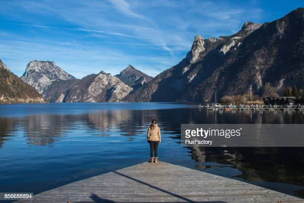 woman near the lake - wonderlust stock pictures, royalty-free photos & images