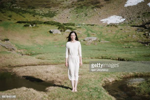 woman near the river in mountains - ドレス ストックフォトと画像